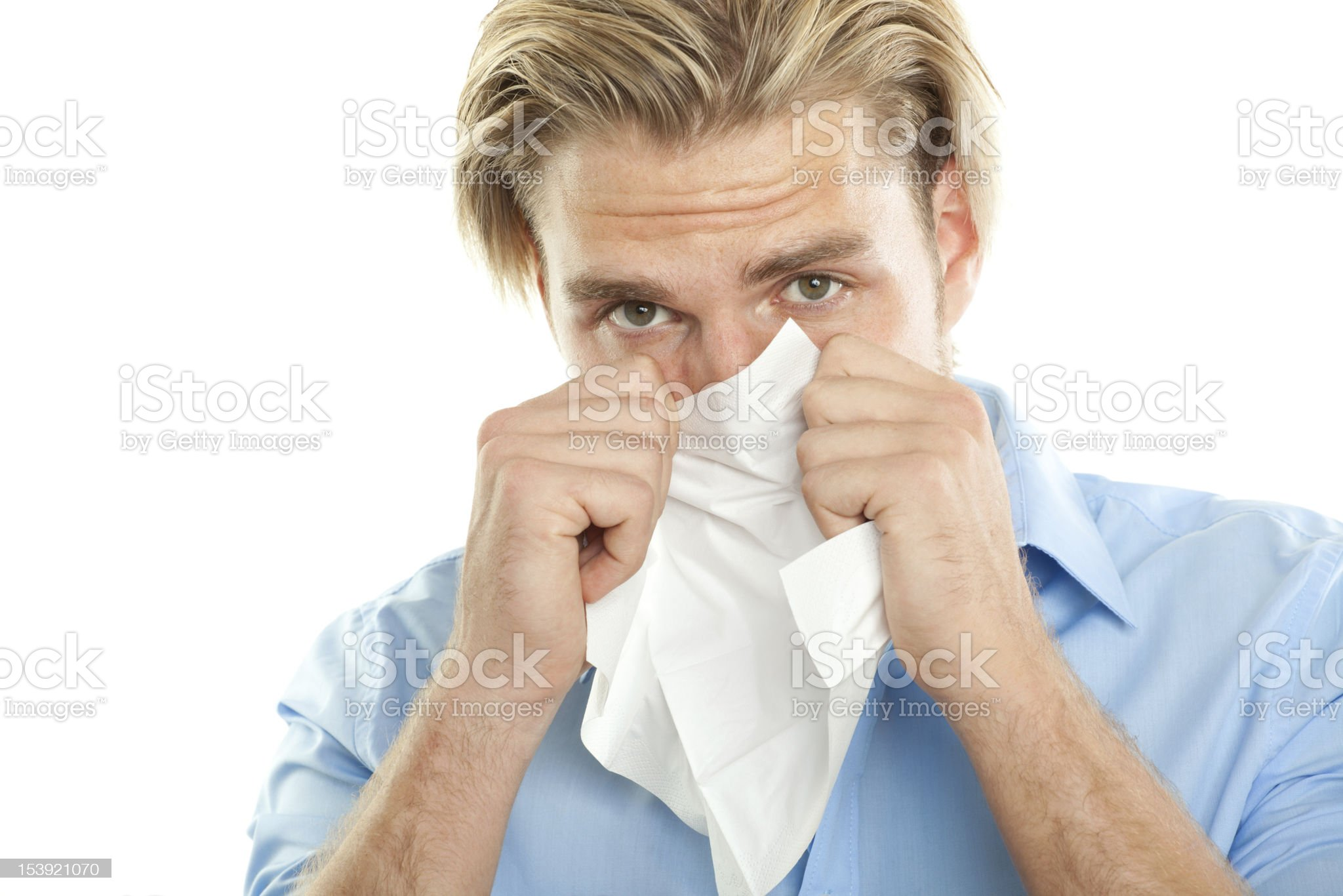 young blond man with tissue royalty-free stock photo