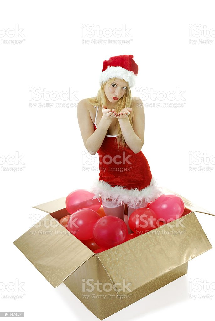 young blond santa girl in a box blowing kisses royalty-free stock photo