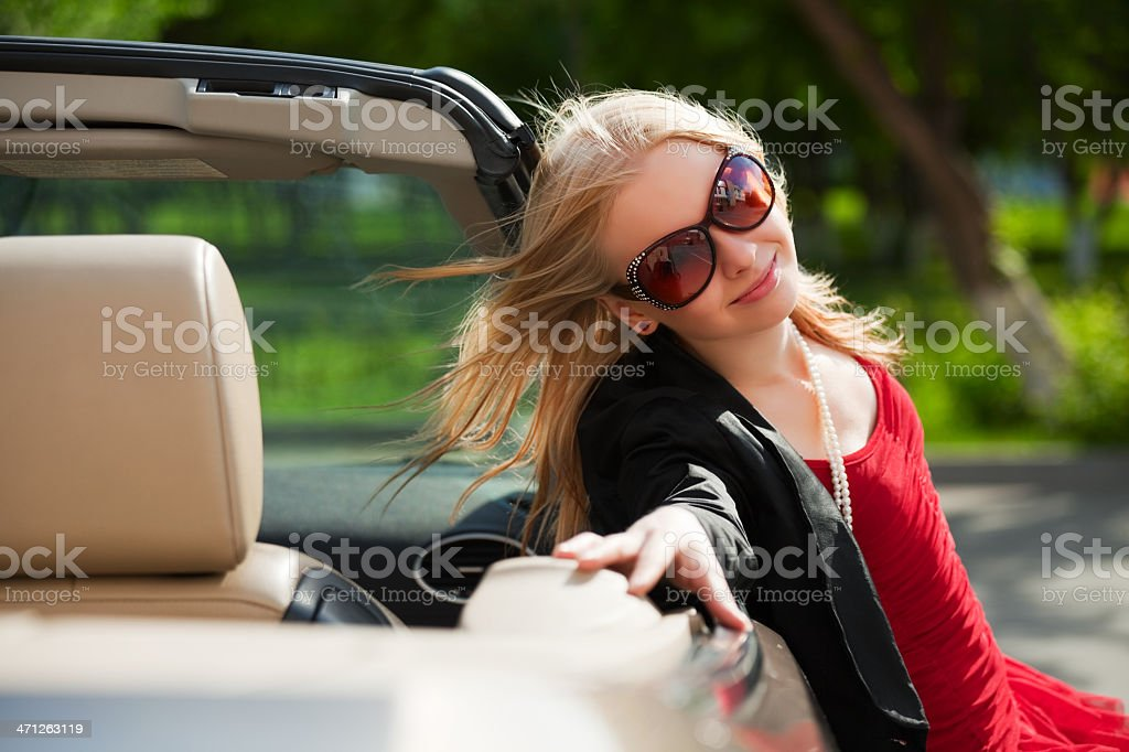 Young blond with a convertible royalty-free stock photo