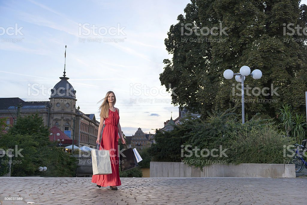 Young blond woman after shopping at the promenade of constance. stock photo