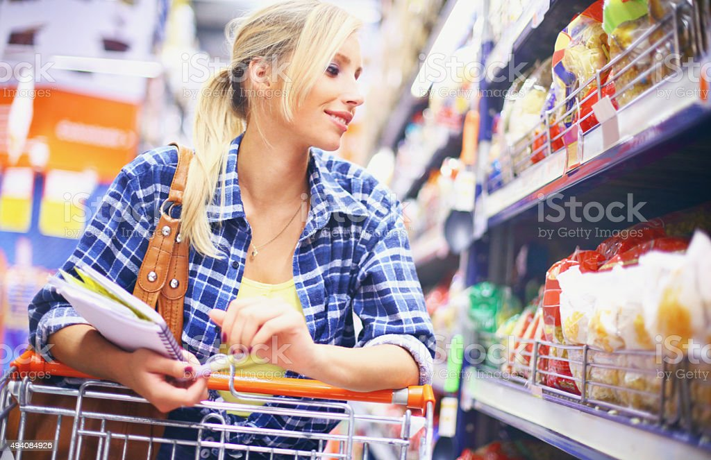 Young blond woman buying food. stock photo