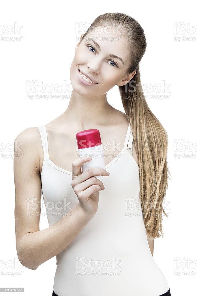 young blond woman holding antiperspirant isolated on white royalty-free stock photo