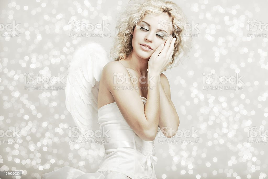 Young blond woman in angel costume stock photo