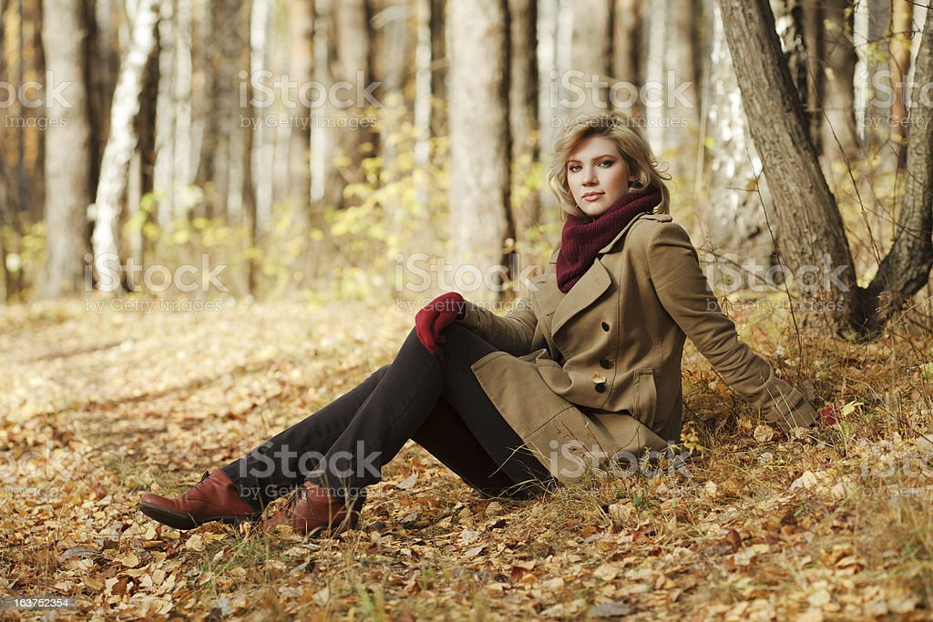 Young blond woman in autumn forest royalty-free stock photo