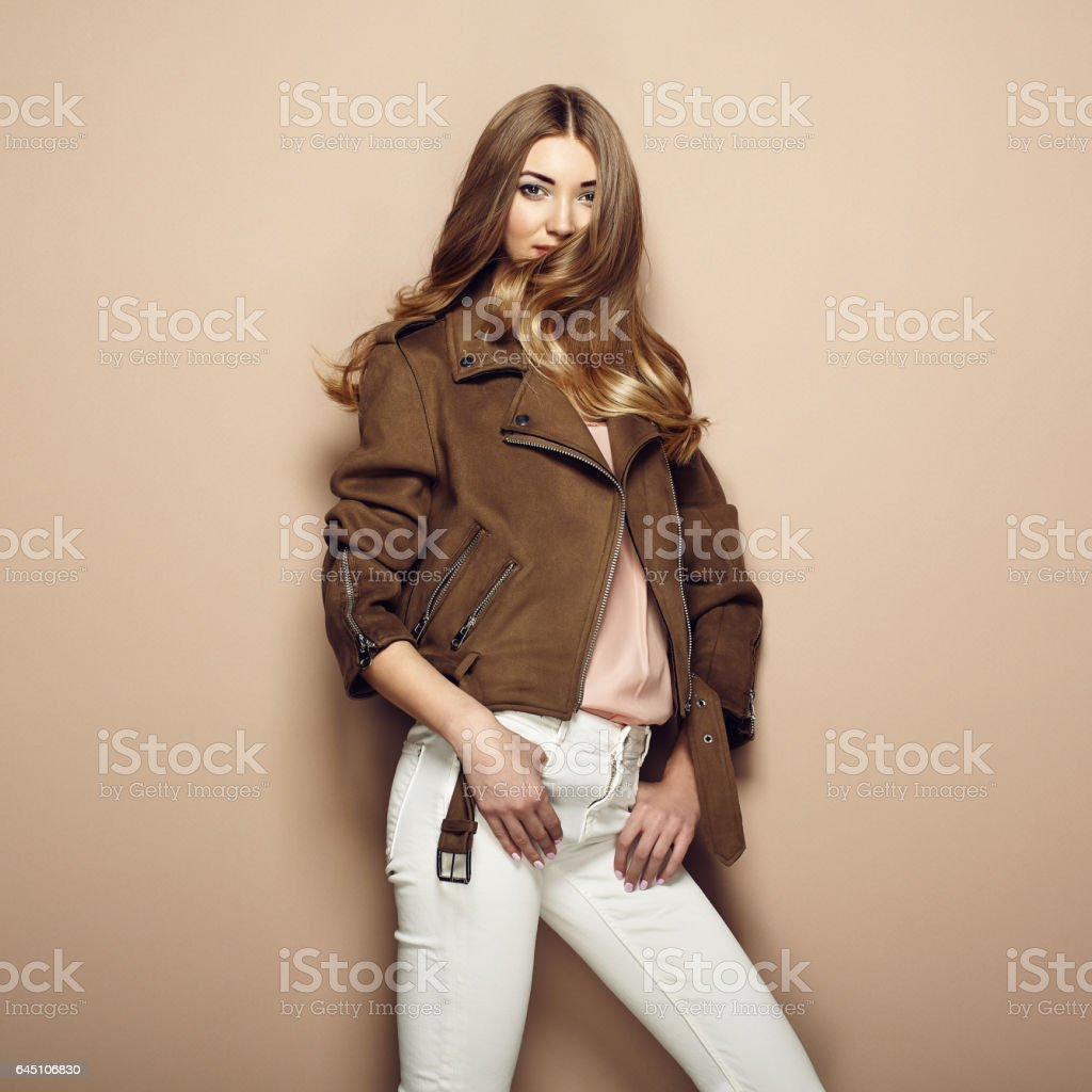 Young blond woman in brown jacket stock photo