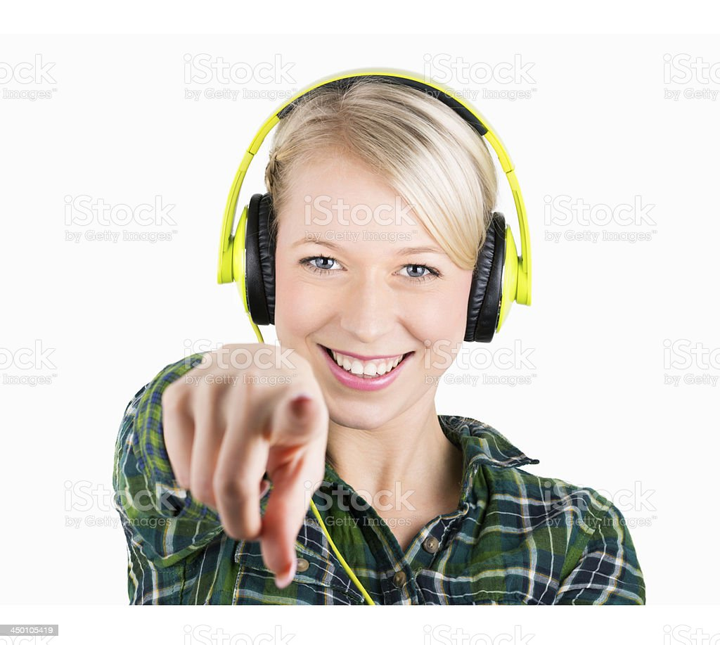 young blond woman in lumberjack shirt  with headphone stock photo
