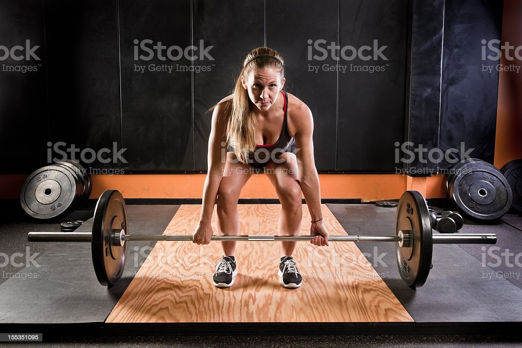 Young Blond Woman Lifting Barbells royalty-free stock photo