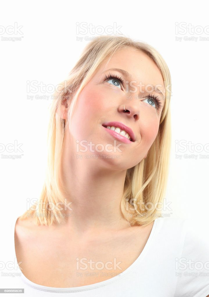 Young blond woman looking up portrait on white stock photo