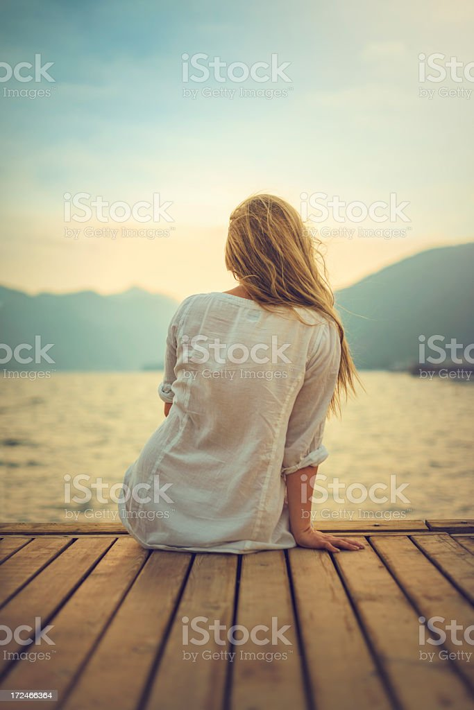 Young blond woman on dock royalty-free stock photo