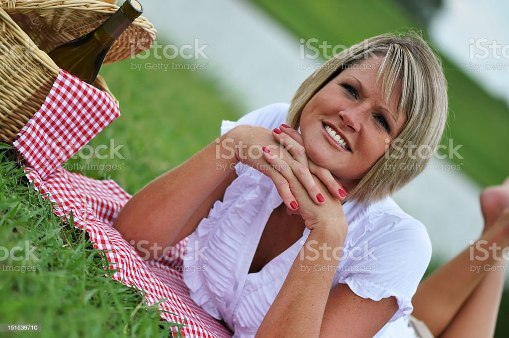Young Blond Woman on Picnic stock photo