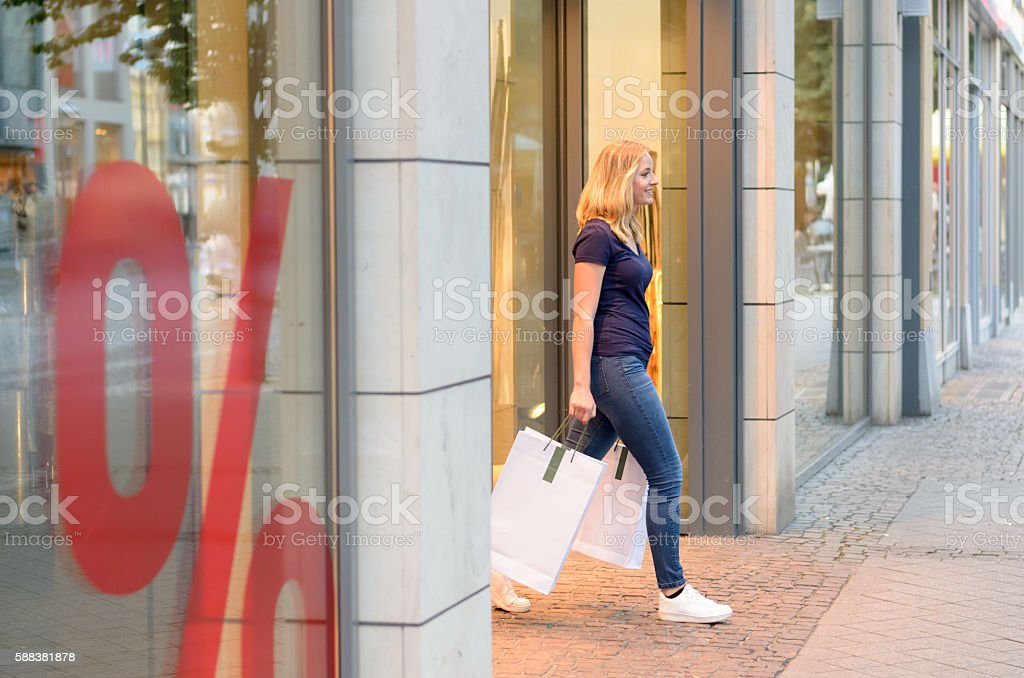 Young blond woman out shopping in town stock photo
