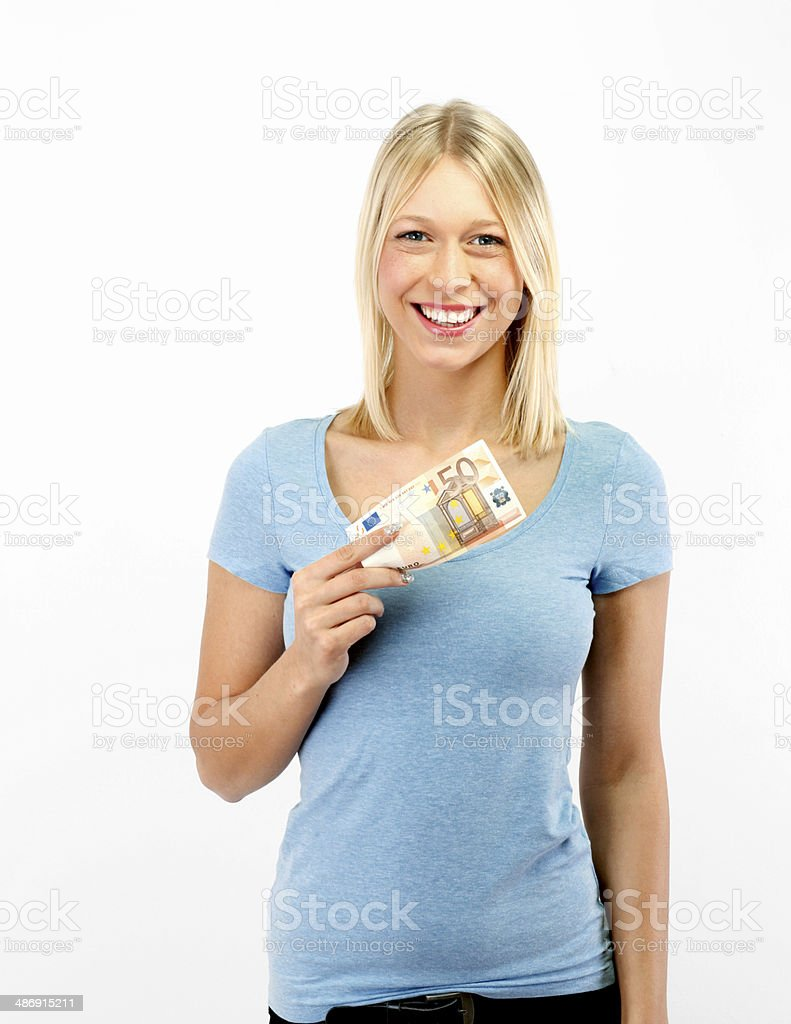 Young blond woman showing 50 Euro stock photo