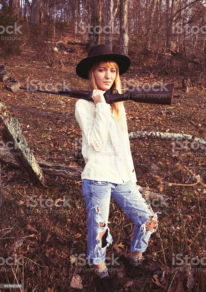 Young blond woman with a gun stock photo