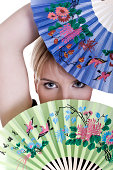 Young blond woman with fans