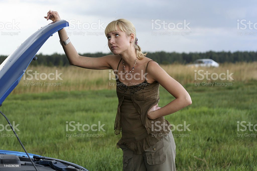 young blond woman with her broken car royalty-free stock photo