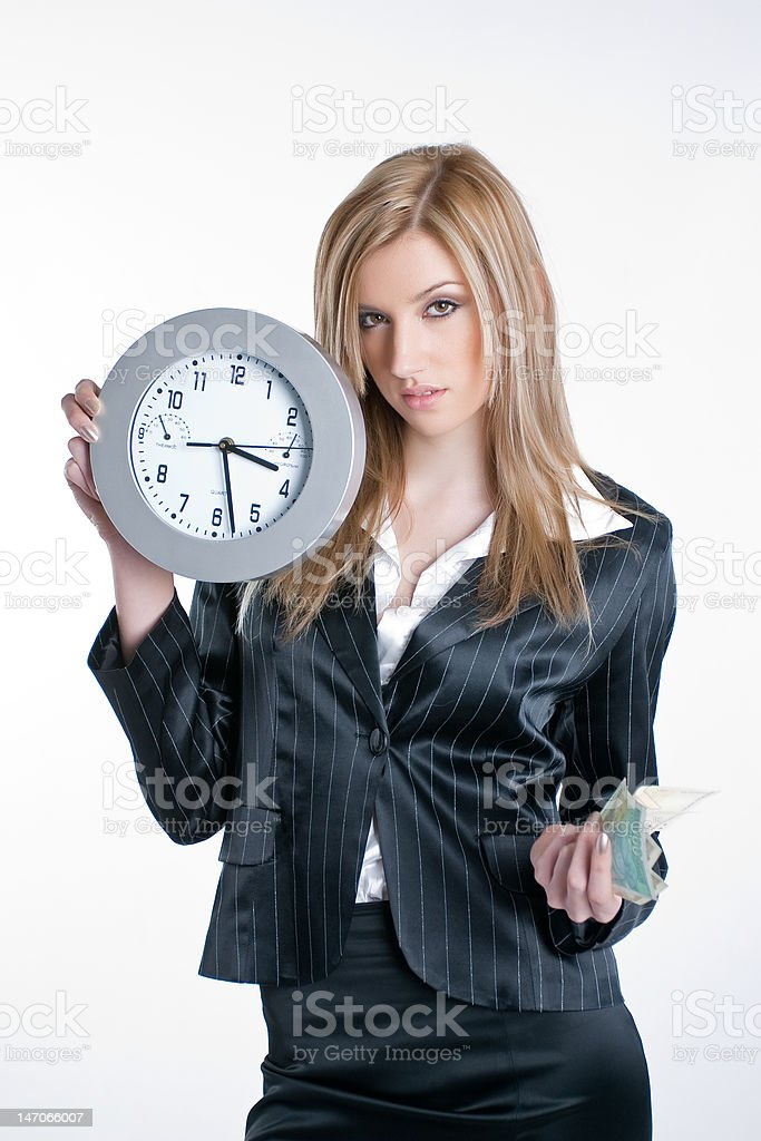 Young blond woman with money and watch in hands royalty-free stock photo