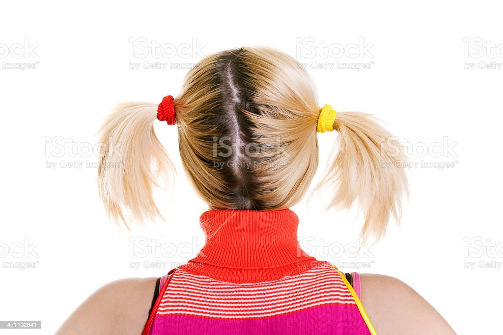 Young blond woman with pigtails stock photo