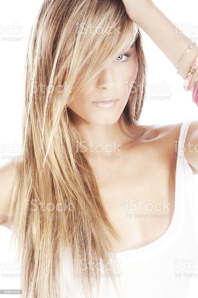 Young blond woman with white tank top and sultry attitude royalty-free stock photo