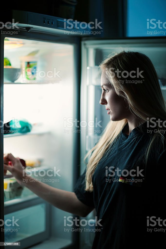 Young Blonde At Refrigerator stock photo