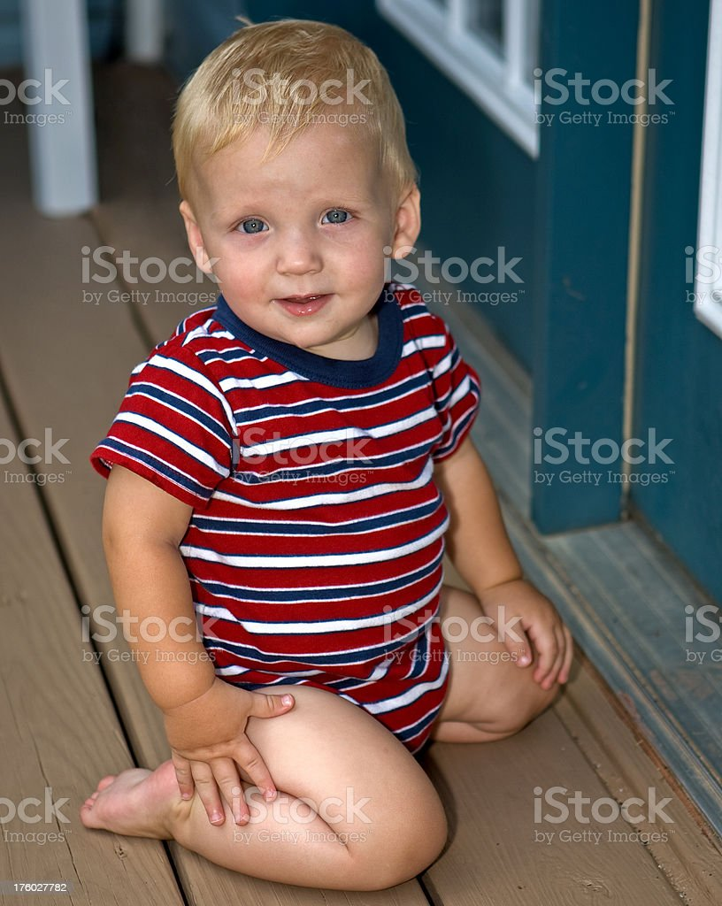 young blonde boy striped jumper royalty-free stock photo