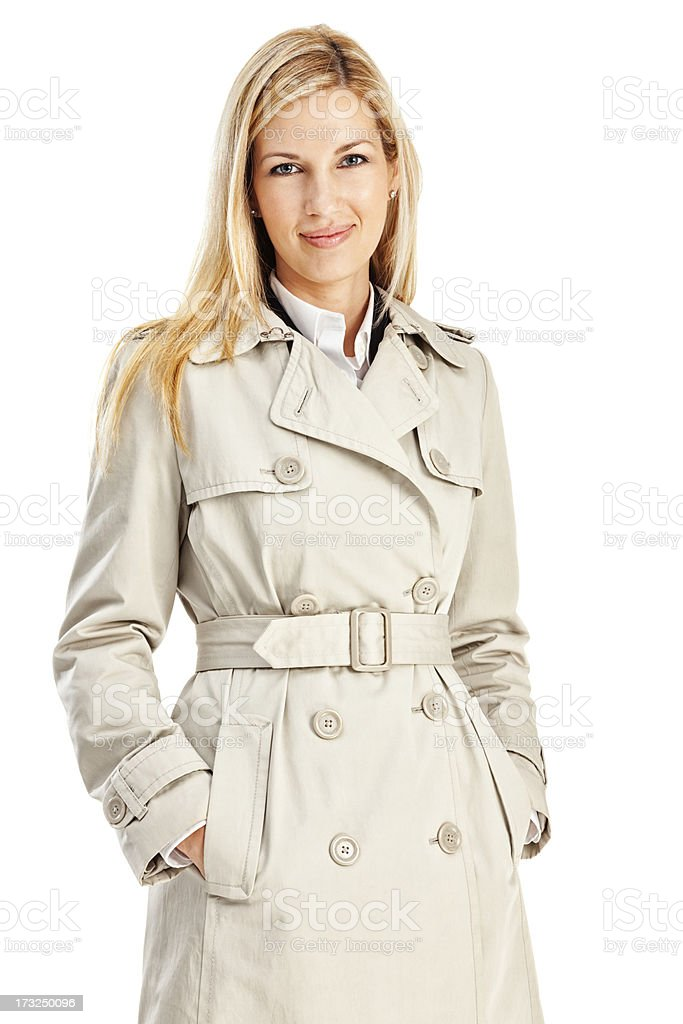 Young Blonde Businesswoman in Tan Trench Coat stock photo