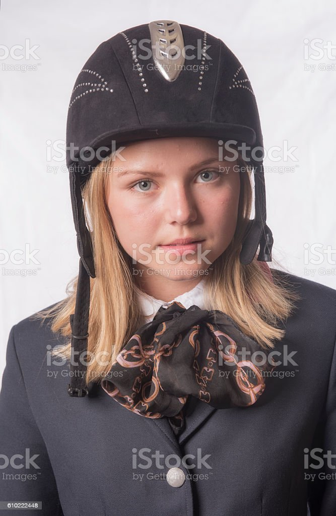 Young blonde female horse rider. stock photo
