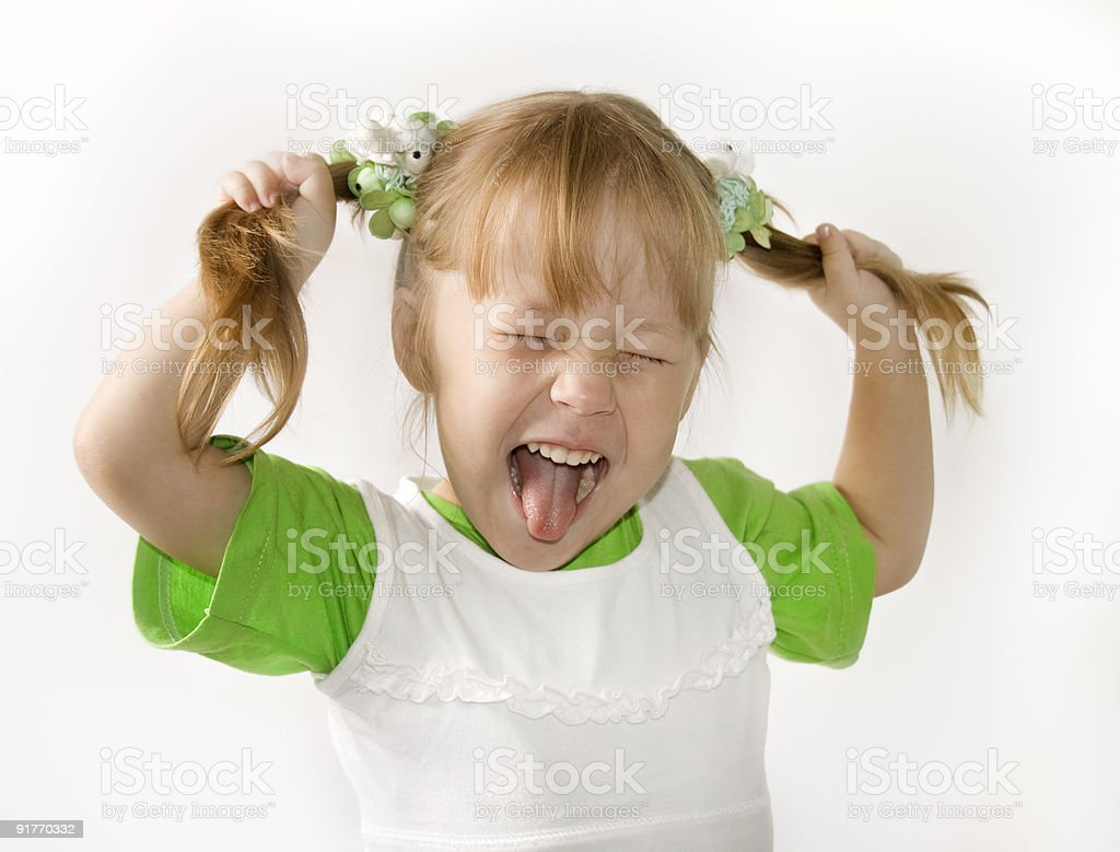A young blonde female sticking her tongue out royalty-free stock photo