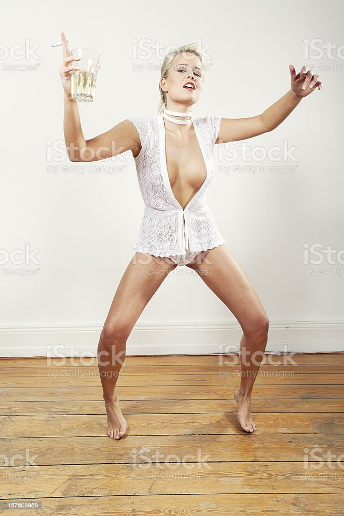 young blonde funny candid woman indoor posing royalty-free stock photo