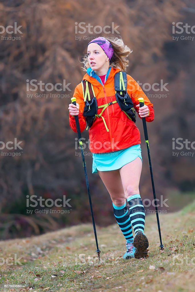 Young blonde girl active practice Nordic walking stock photo