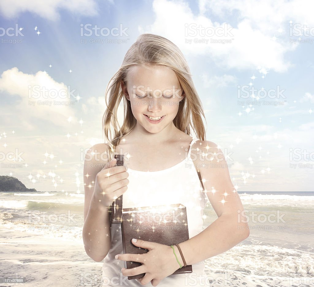 Young Blonde Girl Opening a Gift Box royalty-free stock photo