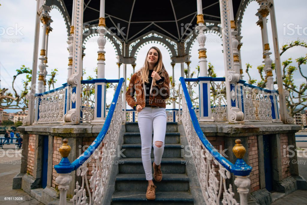 Young blonde happy woman at public park stock photo