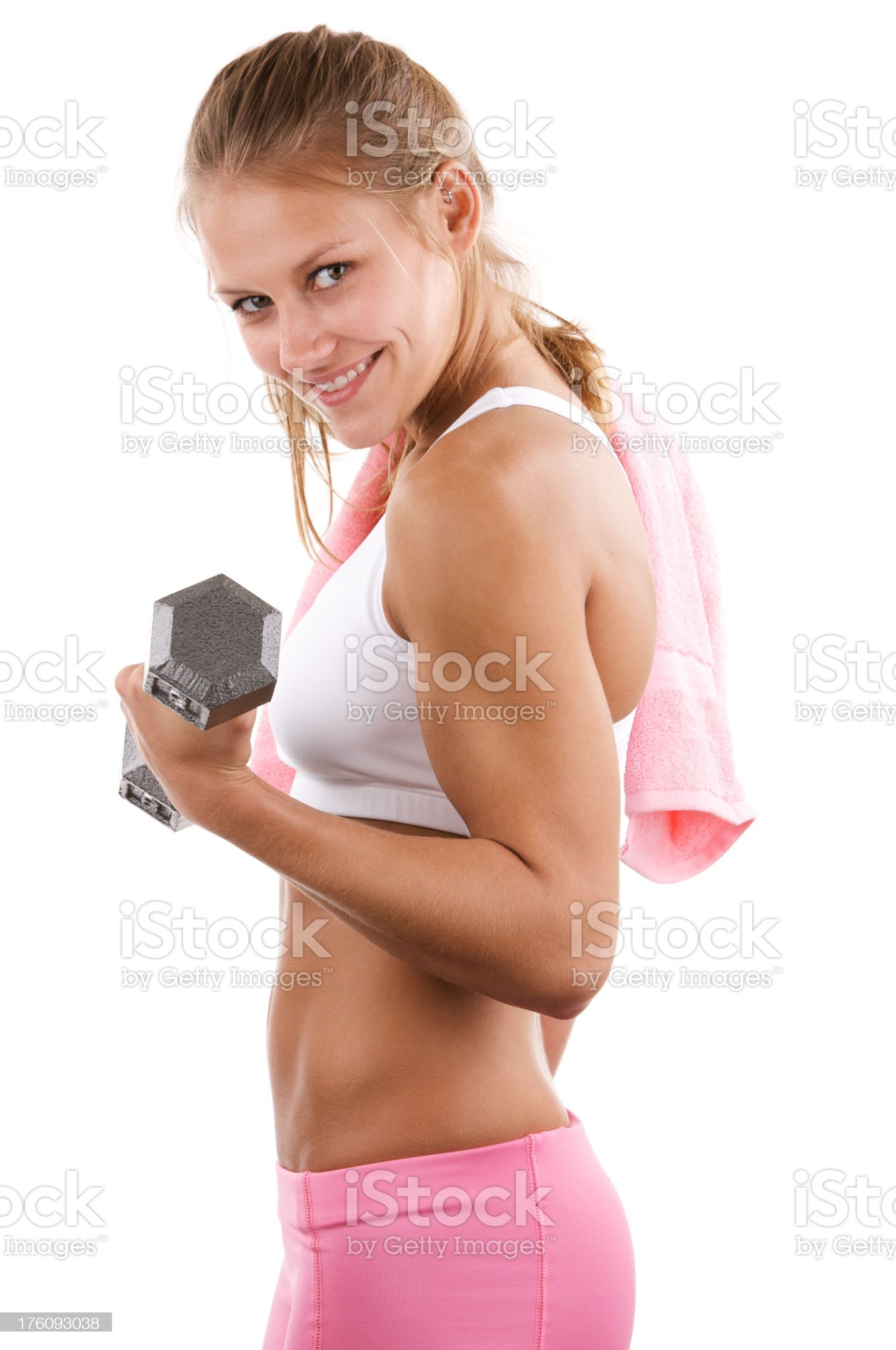 Young blonde lifting dumbbell weight royalty-free stock photo
