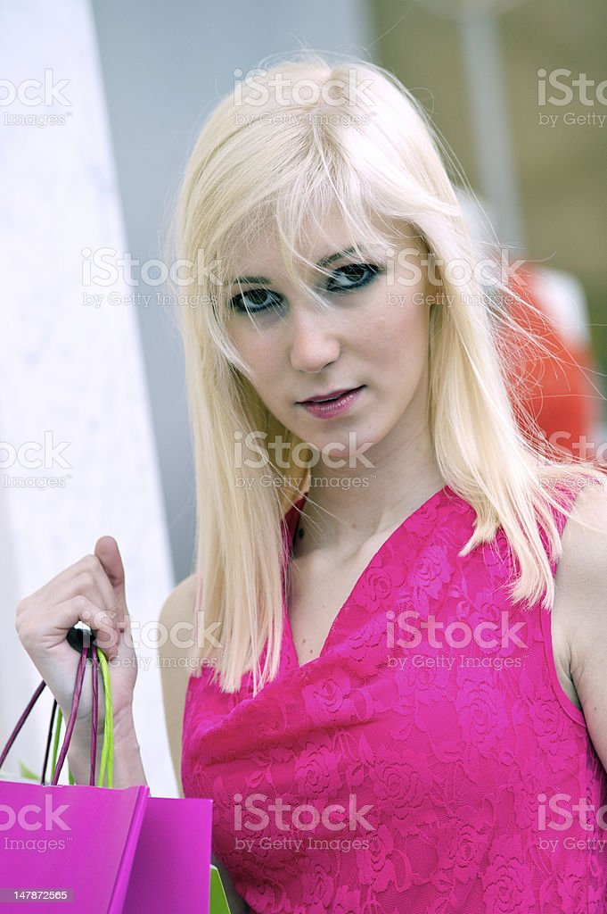 Young blonde shopping woman with bags royalty-free stock photo