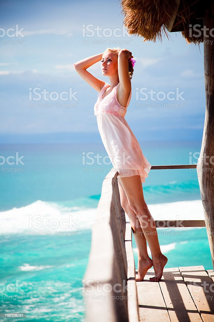 young blonde woman by sea royalty-free stock photo