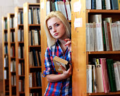Young blonde woman in a shirt with  book in his