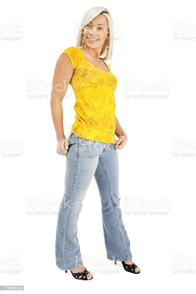 Young Blonde Woman in Jeans and Yellow Tshirt royalty-free stock photo