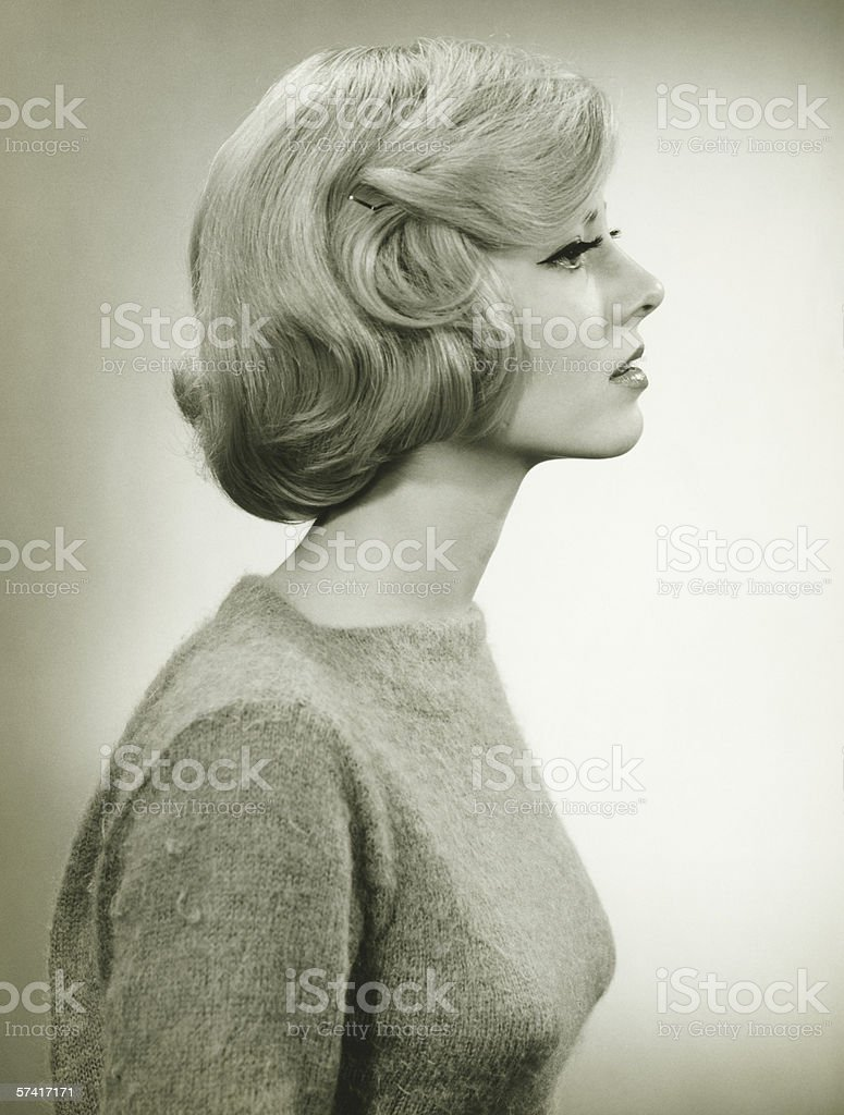 Young blonde woman  in studio, (B&W), (Close-up) royalty-free stock photo