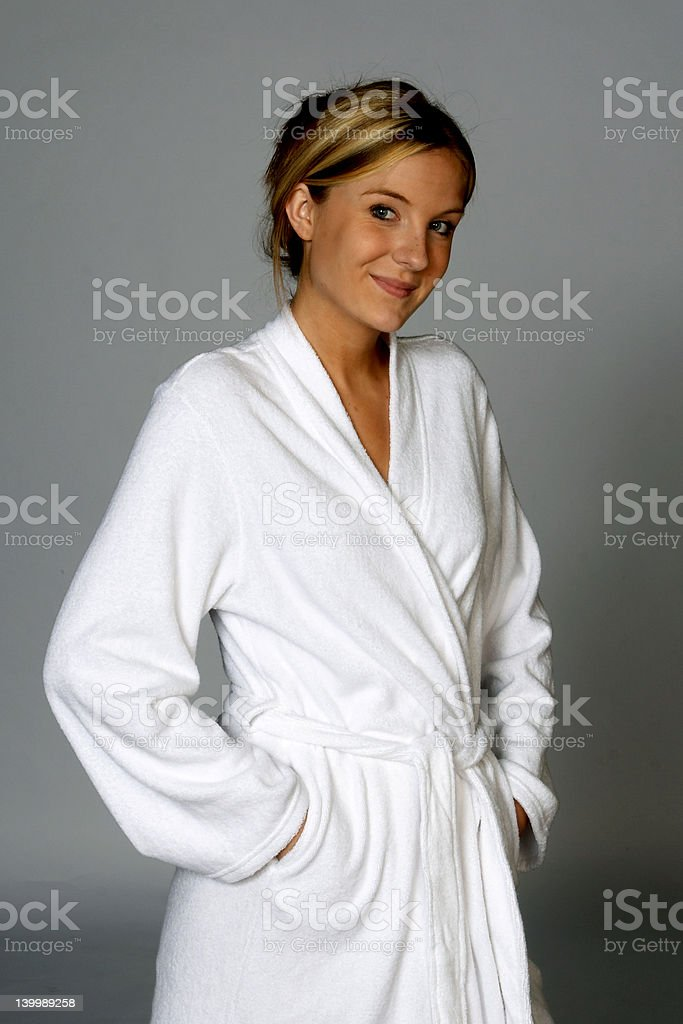 Young Blonde Woman in White Bathrobe stock photo
