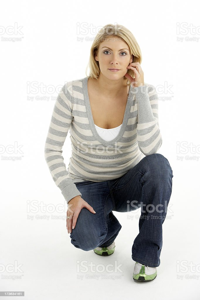 Young Blonde Woman Kneeling royalty-free stock photo