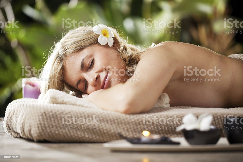 Young blonde woman lying in luxurious spa and relaxing. royalty-free stock photo