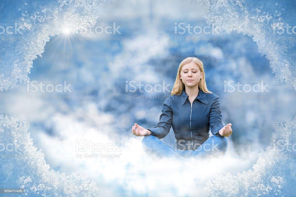 young blonde woman meditating - looks like ice princess stock photo
