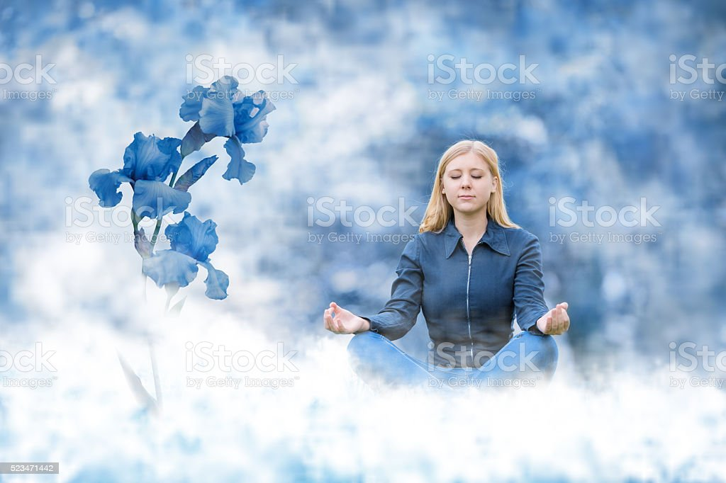 young blonde woman meditating - looks like ice princess stock photo
