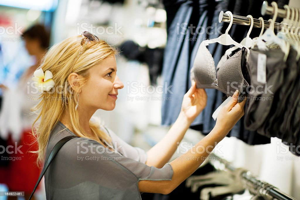 Young blonde woman shopping for bra. royalty-free stock photo