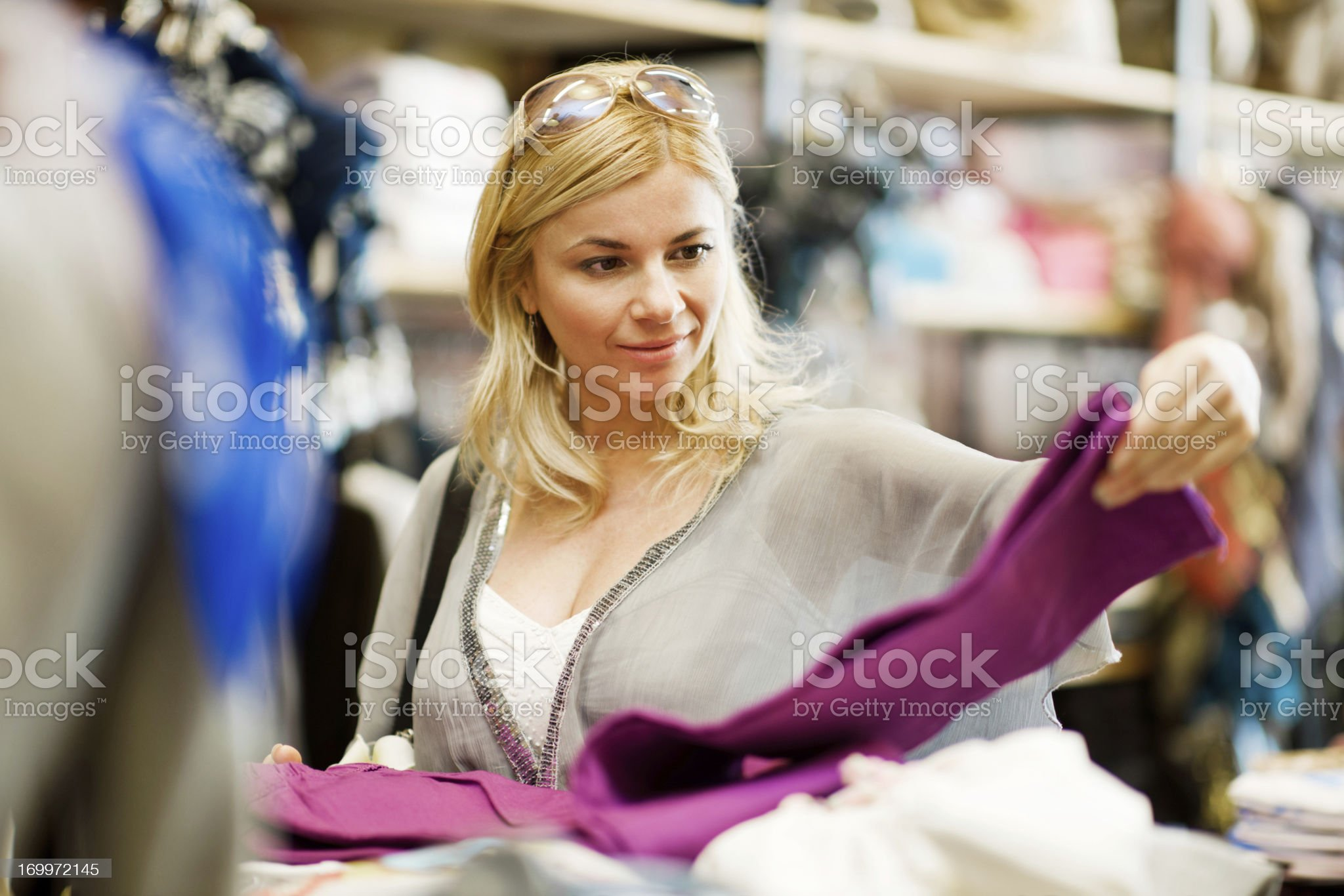 Young blonde woman shopping for clothes royalty-free stock photo