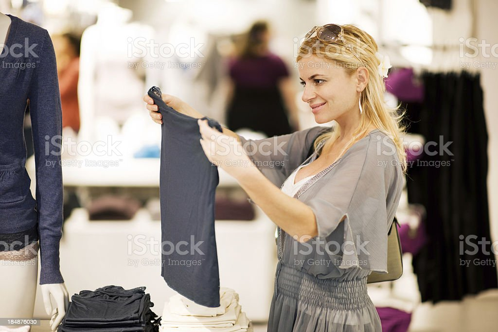 Young blonde woman shopping for clothes. royalty-free stock photo