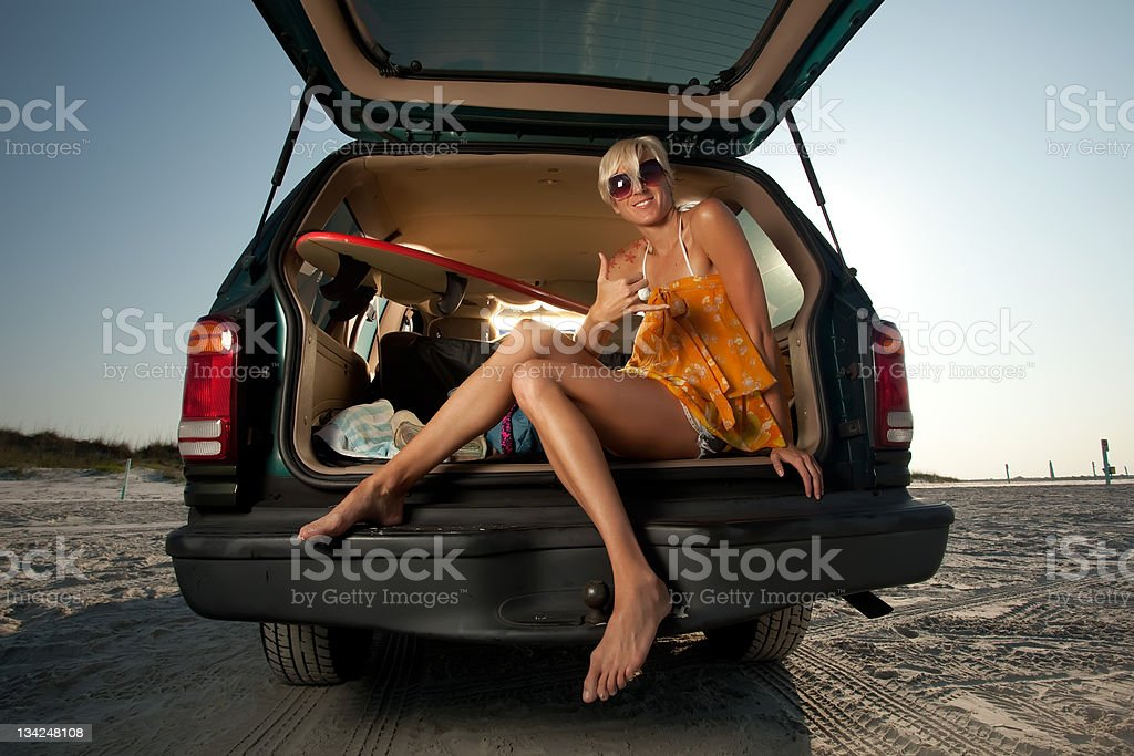 Young Blonde Woman sitting in the back of her truck stock photo