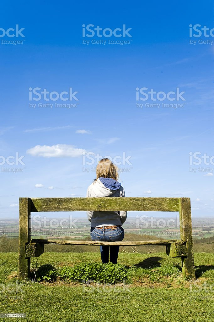 Young Blonde Woman Sitting Outside Enjoying The Bright Summers Day royalty-free stock photo