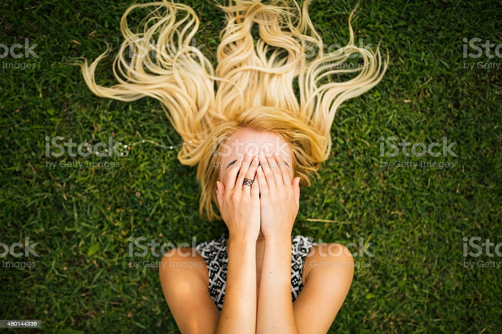 Young blonde woman summer day relaxing stock photo