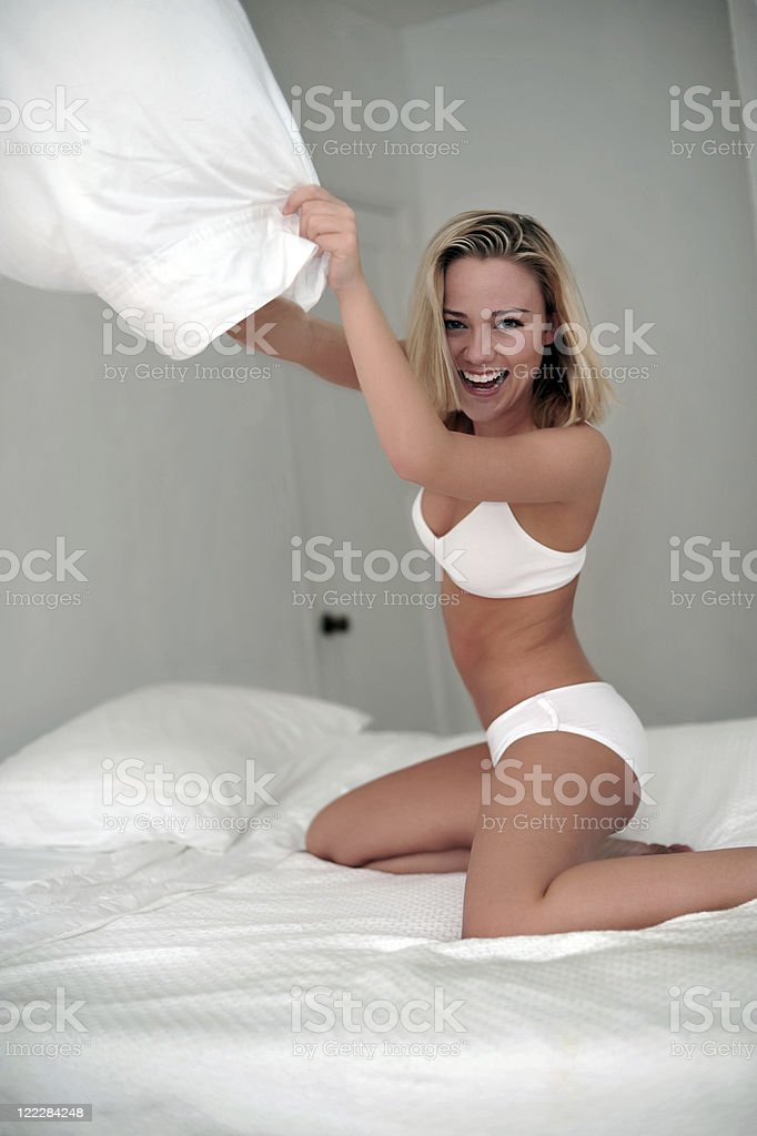 Young Blonde Woman Underwear Model on Bed Pillow Fighting