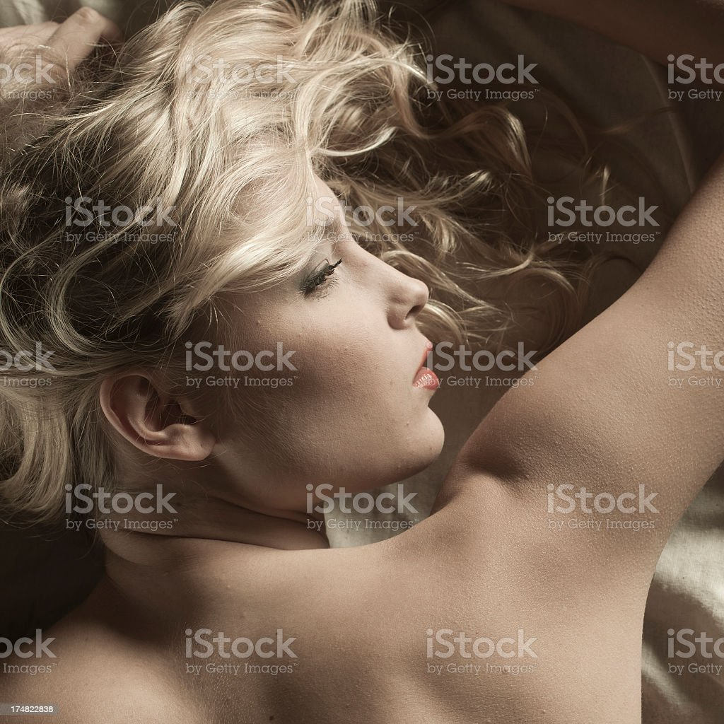 Young blonde women in bed. royalty-free stock photo